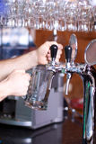 Waiting man pouring beer. Into the glass Stock Photo