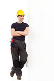 Waiting mechanic lean on the wall Stock Photography