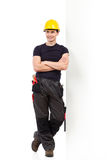 Waiting mechanic lean on the wall Royalty Free Stock Photo