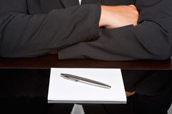 Waiting in a meeting. Businessman with arms crossed in a meeting Royalty Free Stock Photos