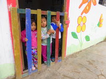 Young children at door of playschool Stock Image