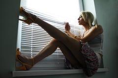 Waiting near the window Stock Photo