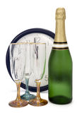 Waiting for New Year. Champagne, three glasses and clock in background. The pointers on a clock shows one minute to midnight (or twelve o'clock am). Clipping Stock Photos