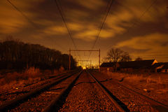 Waiting for the Night Train. Railroad in Flanders during night stock photo
