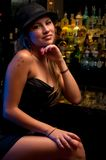 Waiting in the nightclub. Young woman in a nightclub bar, posing very sexy Stock Image