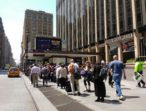 Waiting for a NYC Taxicab in Front of Madison Square Garden stock images