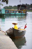 Waiting for an opportunity,. A man waiting for tourists, offers them tour or ride  on the river Royalty Free Stock Photo