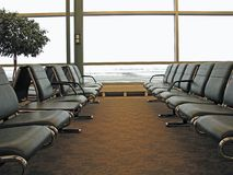 Waiting for passengers. Airport waiting area with chairs for passengers Royalty Free Stock Photography
