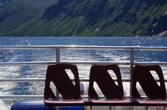 Waiting for Passengers. Three empty chairs on a boat Stock Photos