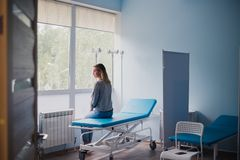 Free Waiting Patient. A Woman Waiting For Medical Examination By Sitting On Treatment Couch Royalty Free Stock Image - 136636016