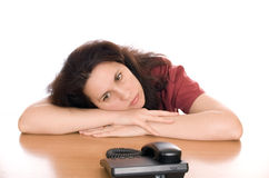 Waiting for a phone call. Young beautiful woman waiting for call isolated Stock Photo
