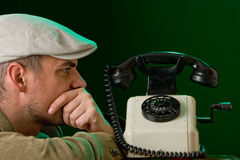 Waiting for a phone to ring. Young man awaiting the news Royalty Free Stock Photos