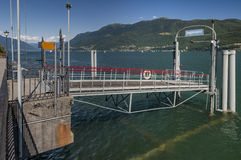 Waiting on the pier at Brissago Switzerland for ferry boat to C Stock Photos