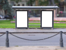 Waiting place of city transport. City bus stop with two publicity boards Stock Photo