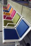 Waiting for the plane!. A waiting lounge with colourful seats Stock Image