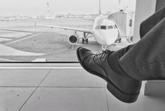 Waiting for a plane at airport Royalty Free Stock Photography