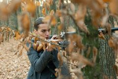 Waiting for Prey. female hunter in forest. successful hunt. hunting sport. girl with rifle. chase hunting. Gun shop. Military fashion. achievements of goals royalty free stock photos