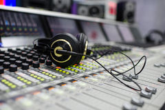 Waiting for producer. A professional headphones on the mixing console Royalty Free Stock Photography
