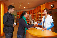 Waiting queue in pharmacy. Waiting queue with customers in a pharmacy with pharmacist Stock Photography
