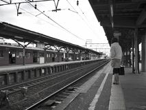 Waiting in a Railway Station Stock Photo