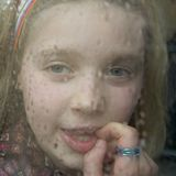 Waiting for the rain to stop. Girl sitting in front of the window Royalty Free Stock Images