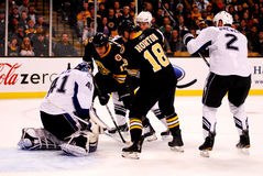 Waiting for the rebound. Bruins Milan Lucic (17) and Nathan Horton (18) wait to see if Lightning goalie Mike Smith (41) will give up the rebound on a Bruins shot Royalty Free Stock Images