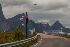 Red light at a narrow bridge. Waiting at red lights to drive over a narrow bridge Royalty Free Stock Images