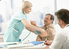 Waiting for results of blood pressure measurement Royalty Free Stock Image
