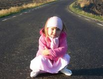Waiting for a ride. A little girl waiting for a ride, soft focus Royalty Free Stock Photo