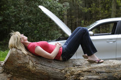 Waiting for roadside assistance female motorist Stock Photos