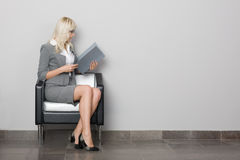 Waiting room. Attractive young business woman sitting in a chair. Waiting room Royalty Free Stock Image