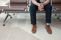 Waiting room. Man sitting in a waiting room with folded arms Royalty Free Stock Photography