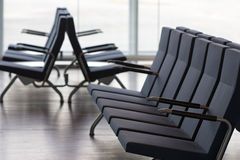 Waiting room. Rows of empty seats in waiting room of modern airport Stock Image