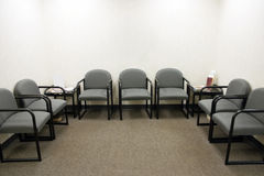 Waiting Room. A ordinary waiting room with gray chairs Royalty Free Stock Photos