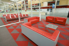 Waiting room. With red armchairs in a railway station Royalty Free Stock Images