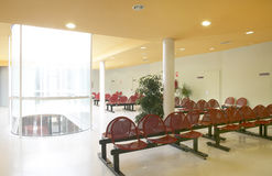 Waiting room area with metallic red chairs Royalty Free Stock Images