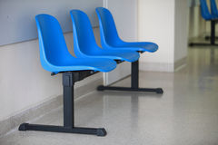 Waiting room blue chairs door Royalty Free Stock Photography