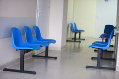 Waiting room blue chairs door Stock Images
