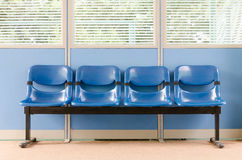 Waiting room blue chairs Royalty Free Stock Photo