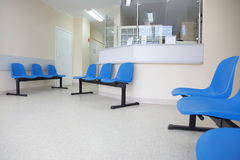 Waiting room blue chairs on the floor Stock Image