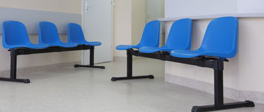 Waiting room blue chairs on the floor Stock Photography