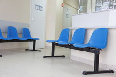 Waiting room blue chairs on the floor Stock Images