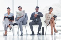 Waiting room with business people Royalty Free Stock Image