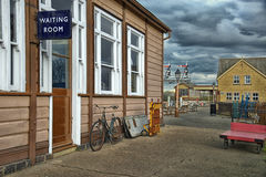 Outside of old wooden waiting room at railway station Royalty Free Stock Images