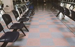 Waiting room at the railway station with empty chairs royalty free stock image