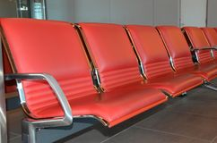 Waiting room with red seats Stock Images