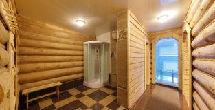 Waiting room between a sauna a shower and the pool. With benches royalty free stock photos