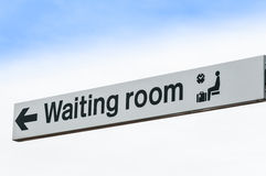 Waiting Room Sign Isolated against Sky Background Royalty Free Stock Photo