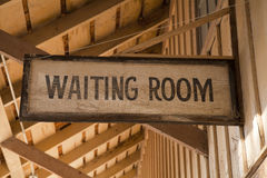 Waiting Room Sign. An old wooden waiting room sign Royalty Free Stock Photo