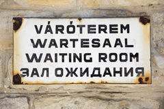 Waiting room sign, words on four languages Stock Photo